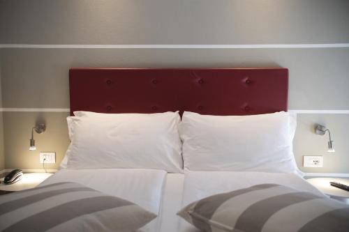 Кровать или кровати в номере Hotel Imperial ***S