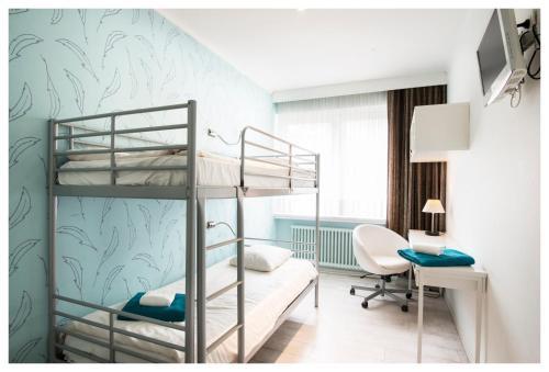 Een stapelbed of stapelbedden in een kamer bij Hotel Ter Streep