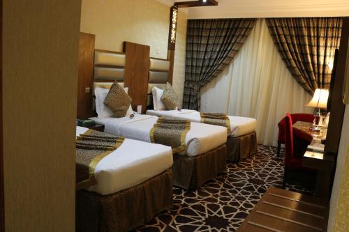 Cama ou camas em um quarto em Province Al Sham Hotel