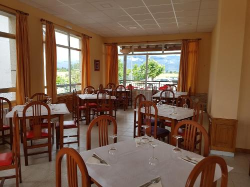 A restaurant or other place to eat at Hostal Orly