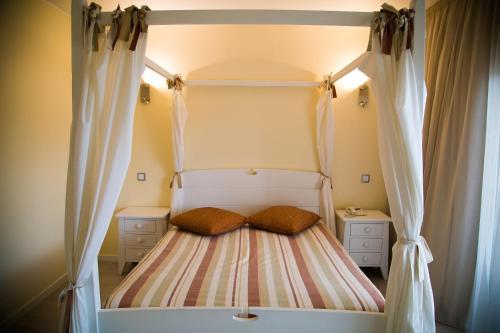 Un ou plusieurs lits dans un hébergement de l'établissement Hotel Dom Fernando