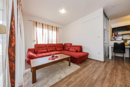 A seating area at apartman Amigo