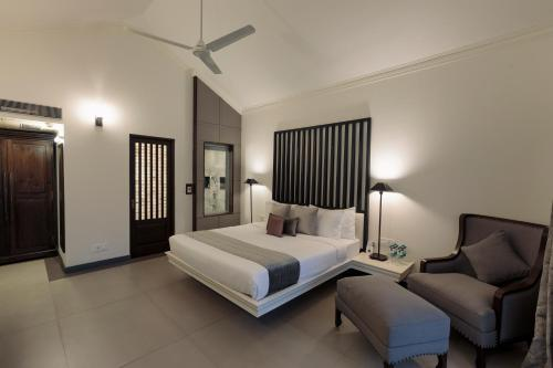 A bed or beds in a room at Andores Resort And Spa