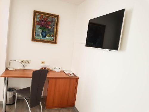Телевизор и/или развлекательный центр в Hotel Bischof