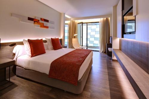 A bed or beds in a room at Olivia Balmes Hotel