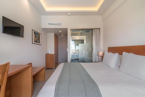 Ένα ή περισσότερα κρεβάτια σε δωμάτιο στο Hotel Palmyra