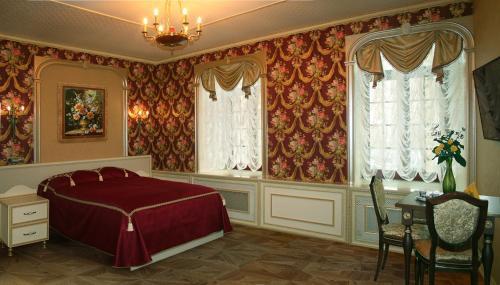 Кровать или кровати в номере Мини-отель Капитель