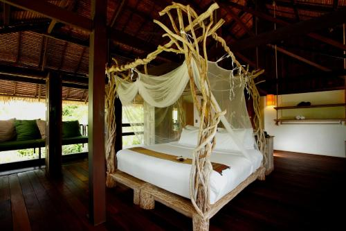 A bed or beds in a room at Koyao Island Resort - SHA Plus