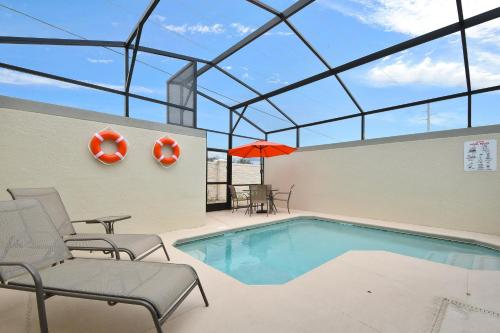 The swimming pool at or close to Five Bedrooms w/ GameRoom and Pool 4894