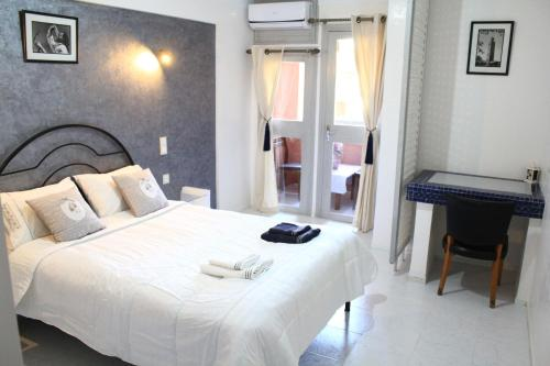 A bed or beds in a room at El Hamra Hotel