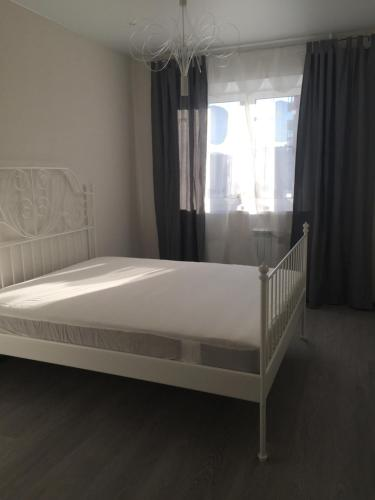 A bed or beds in a room at Happy Apartment on Zelinsky Street 5