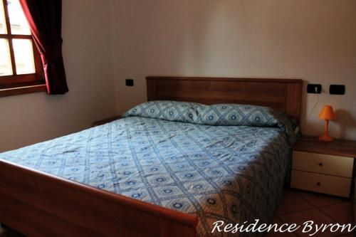 A bed or beds in a room at Residence Lord Byron