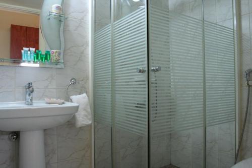 Ванная комната в Byblos Comfort Hotel