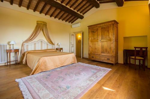 Letto o letti in una camera di Maestà Del Sasso