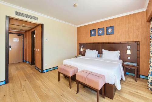 Cama o camas de una habitación en Grande Real Santa Eulalia Resort & Hotel Spa
