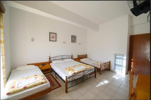 Ένα ή περισσότερα κρεβάτια σε δωμάτιο στο Ολυμπιακή Δάδα