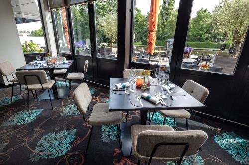 A restaurant or other place to eat at Van der Valk Hotel Leiden