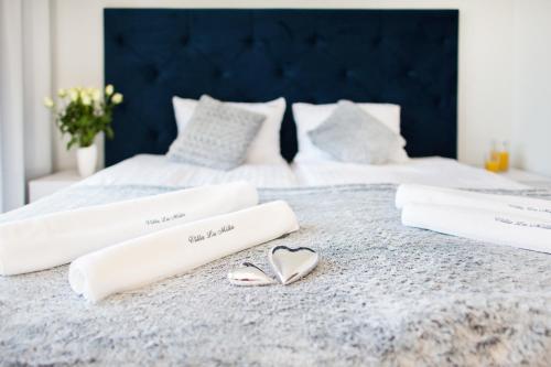 Łóżko lub łóżka w pokoju w obiekcie Villa La Milla