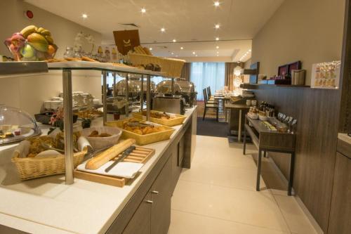מסעדה או מקום אחר לאכול בו ב-Mercure Hotel Brussels Centre Midi