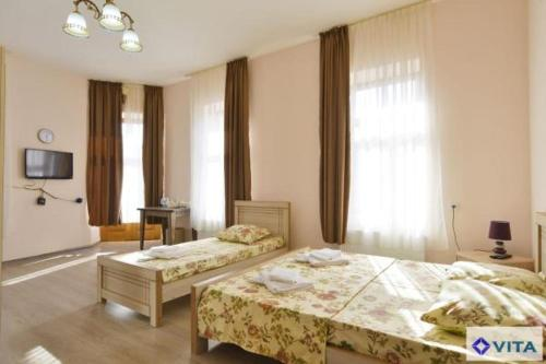 Łóżko lub łóżka w pokoju w obiekcie Hotel Vita
