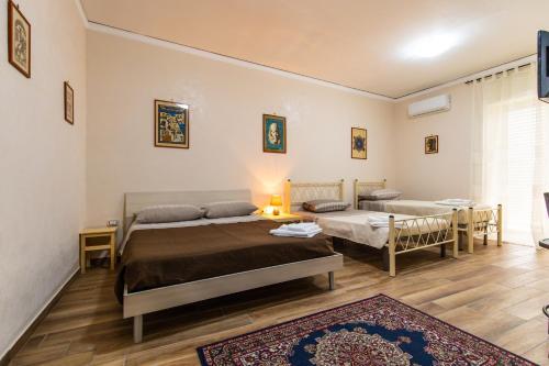 Letto o letti in una camera di B&B Casa di Annarella