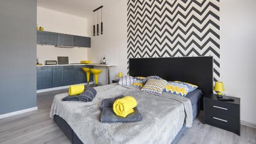 Łóżko lub łóżka w pokoju w obiekcie Apartament Perła Pienin