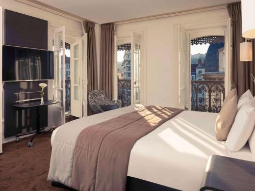 Un ou plusieurs lits dans un hébergement de l'établissement Mercure Lyon Centre Beaux-Arts