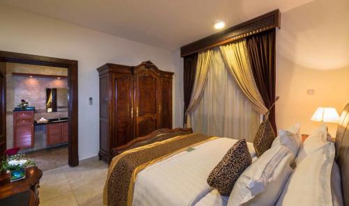 Cama ou camas em um quarto em Boudl Al Nakheel