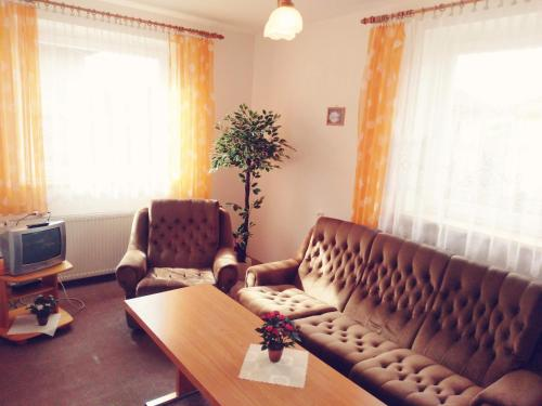 A seating area at Apartmány Horalka