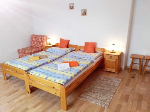 A bed or beds in a room at Apartmány Horalka