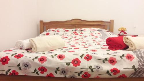 A bed or beds in a room at Green Garden Guesthouse