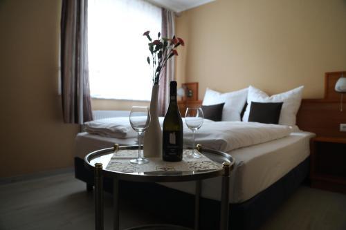 Ein Bett oder Betten in einem Zimmer der Unterkunft Hotel Mykonos