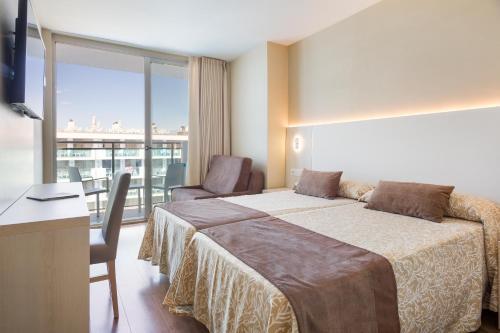 Кровать или кровати в номере Hotel Best Maritim
