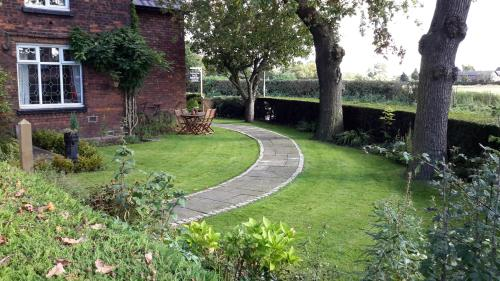 A garden outside The School House