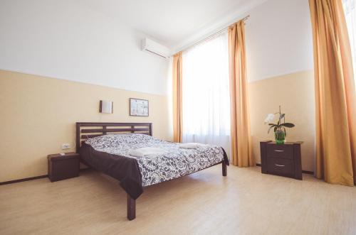 Кровать или кровати в номере Апартаменты Алекс