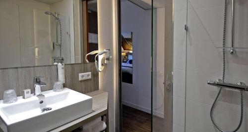 Een badkamer bij Best Western City Hotel Woerden