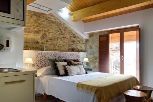 Cama o camas de una habitación en Duerming Rua Travesa