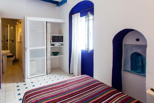 A bed or beds in a room at La Estrella de Tarifa