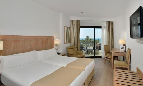 A bed or beds in a room at Melia Costa del Sol