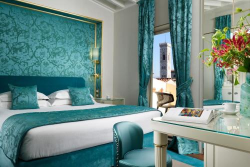 A bed or beds in a room at San Firenze Suites & Spa