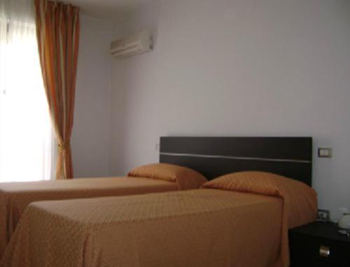 Letto o letti in una camera di Residence Montegrappa