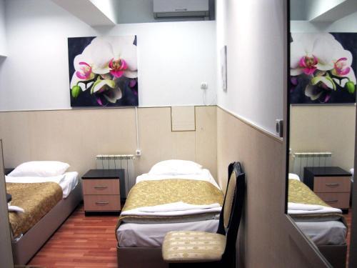 Кровать или кровати в номере Отель Столичная