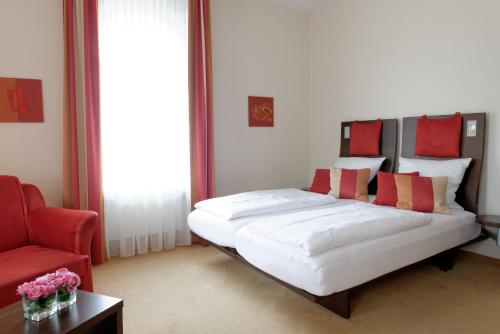 A bed or beds in a room at Maris Hotel