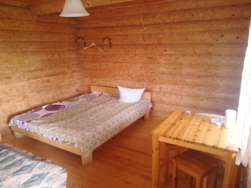 A bed or beds in a room at Kempings Ozianna