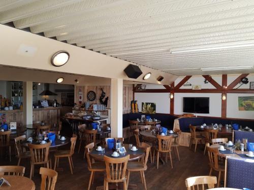 Een restaurant of ander eetgelegenheid bij De Kabbelaar