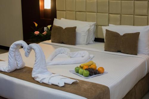 Cama ou camas em um quarto em Al Muhaidb King Abdul Aziz - Al Malaz