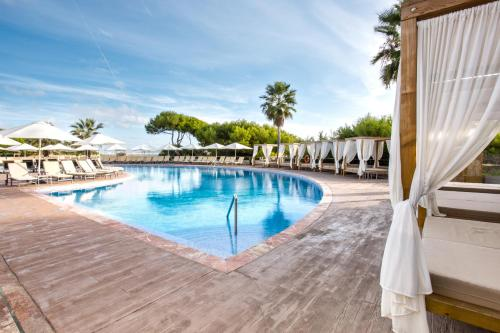 The swimming pool at or near Be Live Collection Palace de Muro
