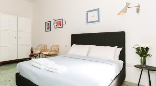 Un ou plusieurs lits dans un hébergement de l'établissement House of Pomegranates