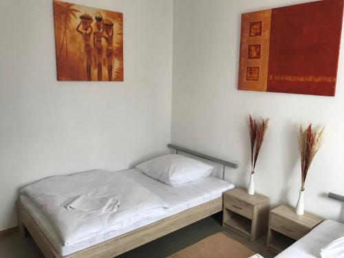 A bed or beds in a room at Schöntal Apartment