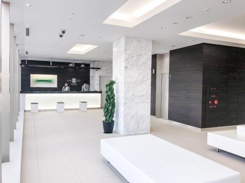 The lobby or reception area at UNIZO INN Shin-Osaka